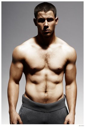 """Details shares outtakes from its photo shoot with Nick Jonas for its November 2014 issue. Promoting Kingdom, where he plays a fighter, Jonas had to pack on pounds of muscle. Talking to Details, Jonas explains, """"I had about six weeks to put on 12 to 15 pounds of muscle before filming started on [DirecTV's] Kingdom–my character is a fighter whose strong suits are wrestling and grappling. Diet had a lot to do with it. I went from consuming about 3,000 calories a day to 4,200! Paleta, a food-delivery service, sent me three meals a day and snacks. It was an incredible way to know that I was getting what I need to build muscle and not have to think about it. Breakfast was usually an omelet with veggies and cashew cheese, a turkey-meat patty, and some fruit; lunch and dinner would be lean protein, veggies, and nuts; snacks consisted of things like snap peas with peanut sauce."""" Read more at Details.com."""