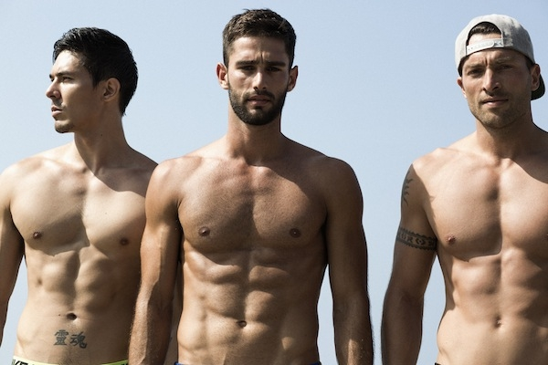 Photographer Gregory Vaughan captures a Mahamudra workout session (a mix of meditation, yoga, and calisthenics popular in L.A. and Brazil) with three handsome strangers on Manhattan Beach, Ca., for The Most Beautiful Man in The World.