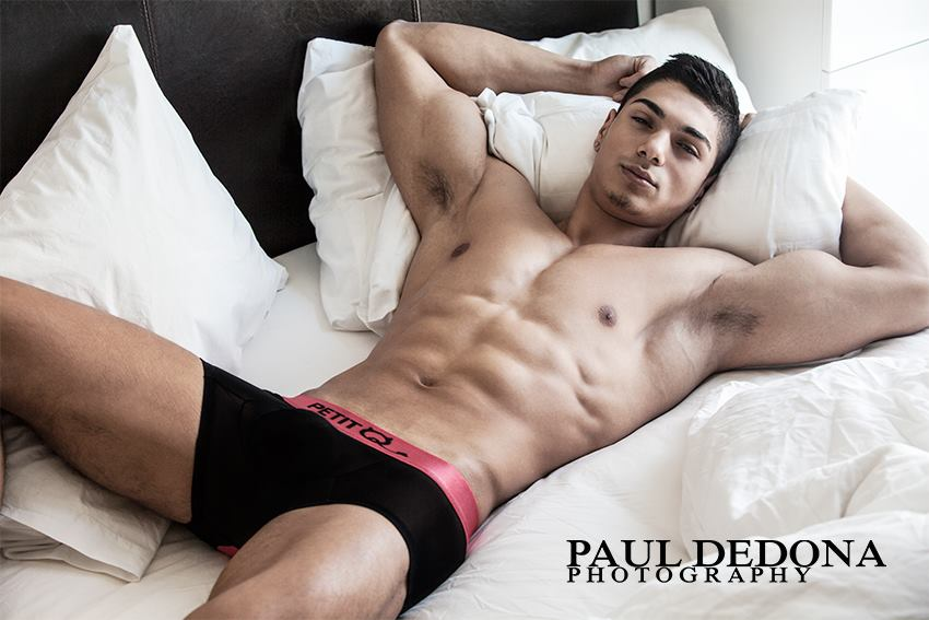 Paul Dedona loves bringing sexy boys into his bed. This time Paul is introducing Andrei. Andrei is a waiter in London and it's his first time posing in front of a camera and we can tell he's good and not shy wearing PetitQ provocative underwear.