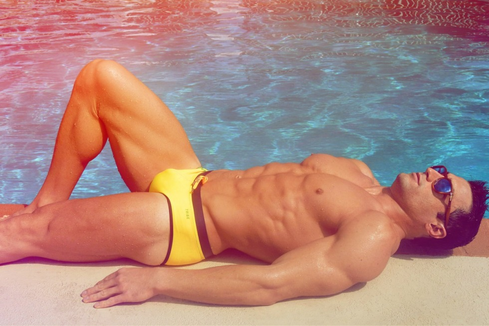Fitness male model John Catanzaro wearing Tribe Swimwear shot by MiLo800. John is signed at ONY Models International.