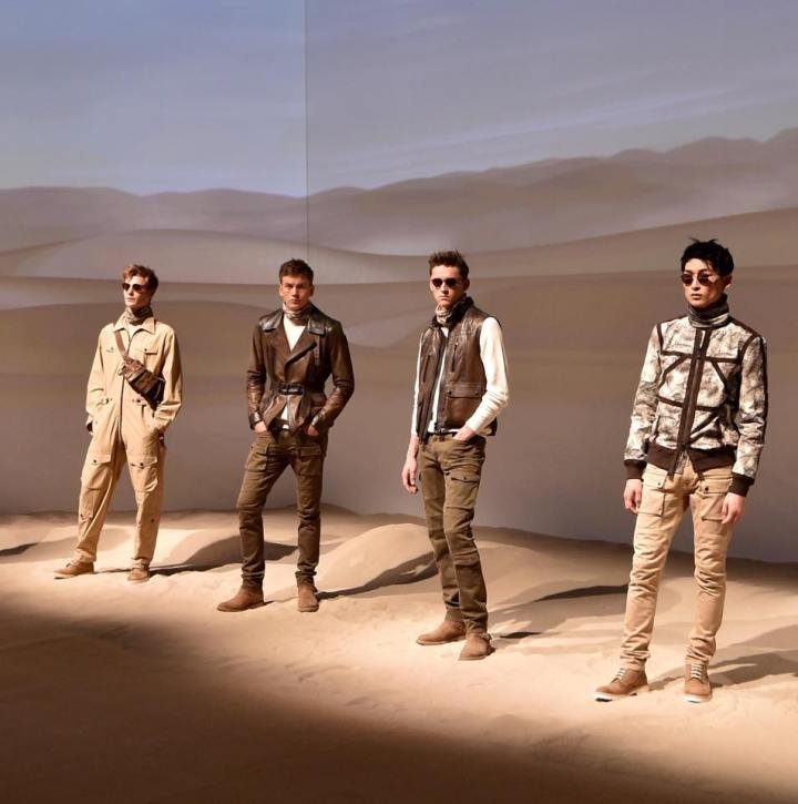 "The British brand that built its name on moto-inspired outerwear, left the open road behind and braved the desert dunes, showing off a handsome collection with a vintage military feel and strong whiff of ""The English Patient."""