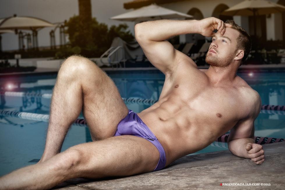 Fitness male model Alex C. wearing pieces from Ergowear Swimwear snapper by Armando Adajar.
