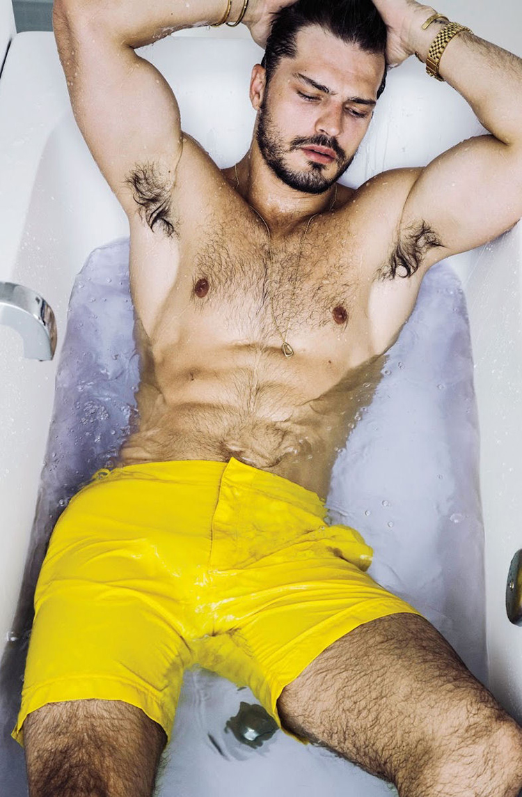 Sizzling Brazilian supermodel Diego Miguel is submerged in a bathtub posing in a variety of swimwear pieces for the latest issue of 'Men's Weekly' masterfully shot by photographer Renie Saliba.