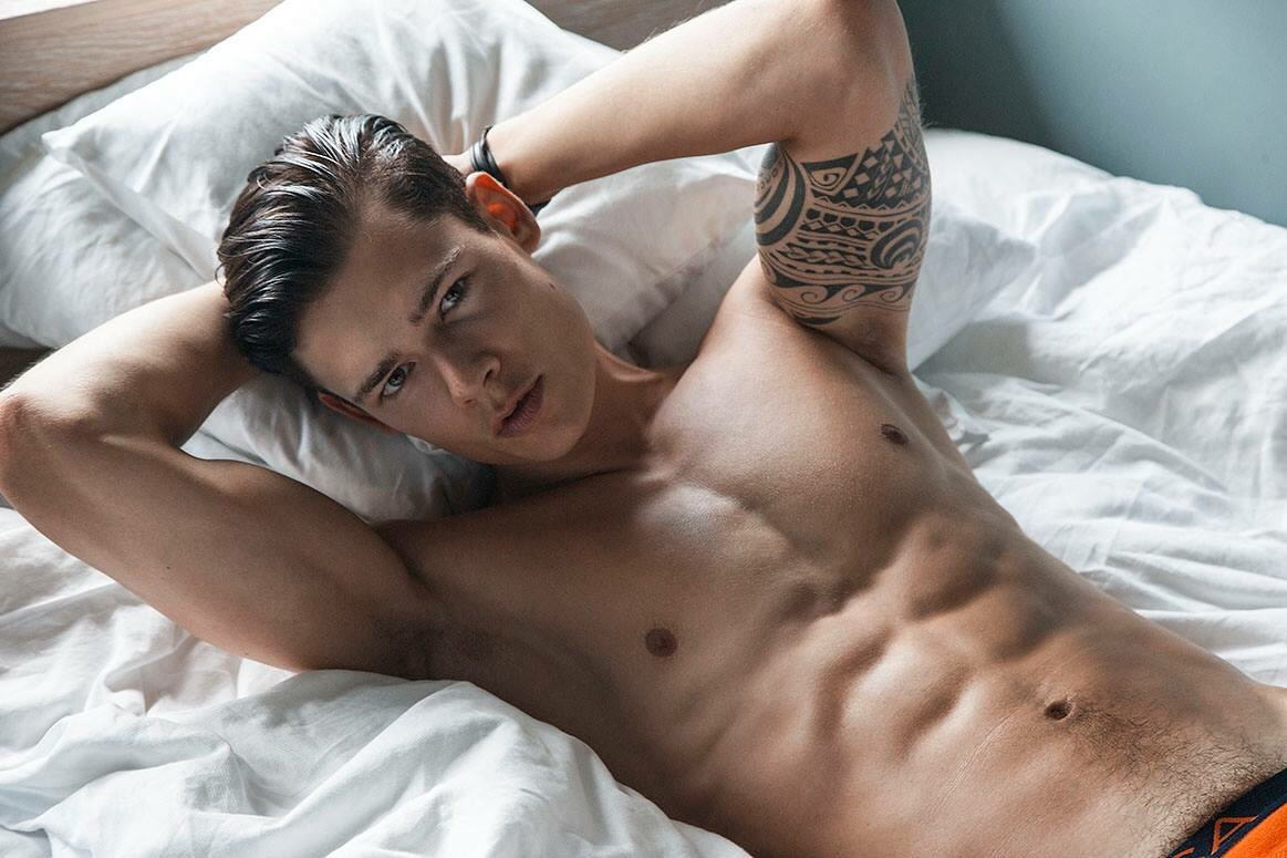 male models nude on beds