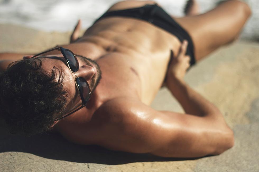 Meet Spanish Javi Olmeda getting tan in speedos, shooting by Toni Lozano.