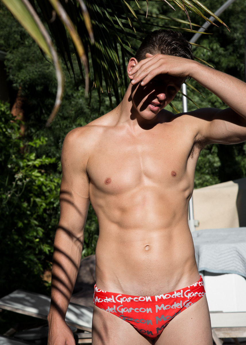Model Alex Valley shot by Ted Sun for Adon Magazine is showing off his life guard washboard abs.