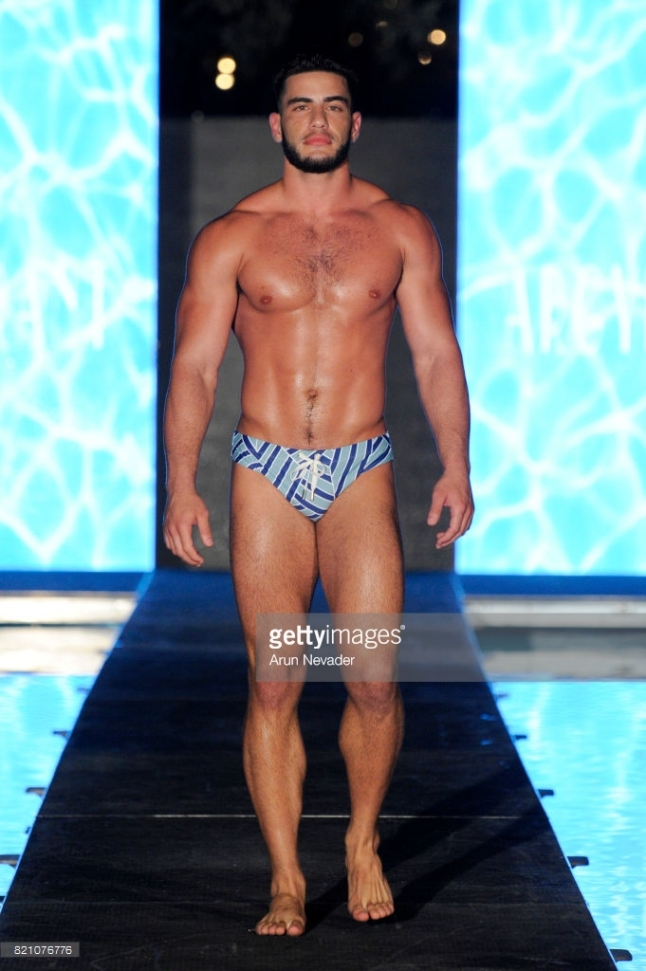 A model walks the runway at the Argyle Grant fashion show during the Art Hearts Fashion at Miami Swim Week at SLS Hyde Beach on July 22, 2017 in Miami, Florida.